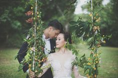 Engagement shot with a handmade swing covered in flowers | Reservoir Romance: A Forested Styled Shoot - Part 1