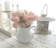 Dusky pink roses in an antique white ironstone pitcher I found at a thriftstore for a few dollars.