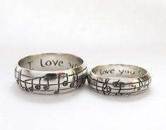 I found these on Etsy & they are a unique idea :) I love them!!! Your Song Wedding Rings Any Song One of a Kind by Myfavoritesong, $449.00