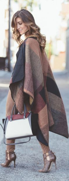 Wear your brown, black and burgundy coloured poncho over matching leggings and shoes. Via Deniz SelinSatchel