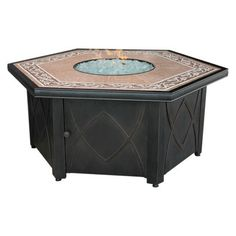Uniflame Ceramic Tile Hexagon Propane Gas Fire Pit  I could see a table and chairs in the pergola are and this and chairs next to it on a paver covered patio area.