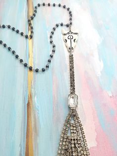 """Death to Life"" - 1950's rhinestone tassel hung from carved bone skill on a hematite beaded chain"