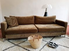 Fashion blogger Aurelia Mamou's stunning '70s inspired living room with a brown velvet sofa and vintage beni ourain   the Absolutely Glamorous blogger updated her IKEA Karlstad sleeper sofa with a Bemz cover in Acorn Zaragoza Vintage Velvet from our collaboration with Designers Guild