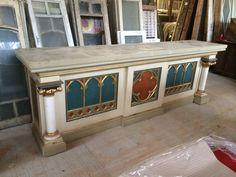 Antique European church furniture in old paint.