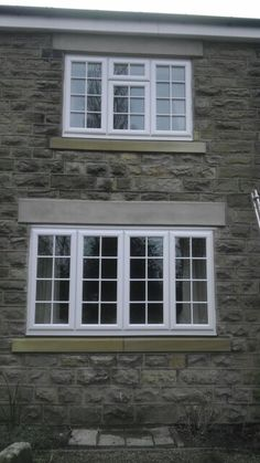 White PVC-u windows with internal/external Georgian bar manufactured and installed along with mock stone lintels by Bowfield Window Systems, Chesterfield www.bowfieldwindows.com