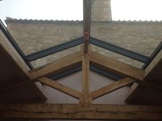 Internal view of PR60energysave ridge rooflight - the mullions perfectly aligned with the oak roof trusses.