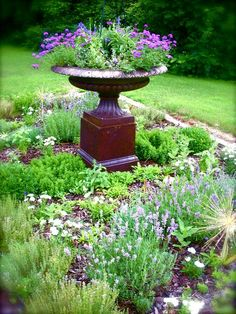 Simple herb garden with an urn as center piece