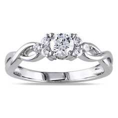 Celebrate your engagement with this beautiful Miadora 14-karat white gold diamond ring. The ring's classic round-cut diamond brings a traditional flair to the modern-style band. Six diamond accents hu