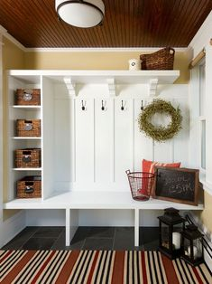 Country Entryway with Somette Tributary Allison Stripe Red Indoor/ Outdoor Rug, Built-in bookshelf, Paintable White Beadboard