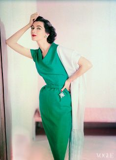 Dovima in an emerald green dress.