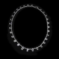 This exquisite showstopper showcases 30 elongated cushion cut stones and over 150 pave set cubic zirconia stones. This sterling silver necklace measures at 18 1/2