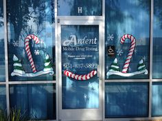 Holiday window painting, candy canes & little trees