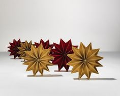 Sterne in 3 Größen gefertigt aus Perlmutt-schimmerndem Feinstpapier