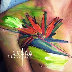 Acrylic style tattoo of the bird of paradise flower on chest/collarbone/shoulder. By Ivana Belakova.