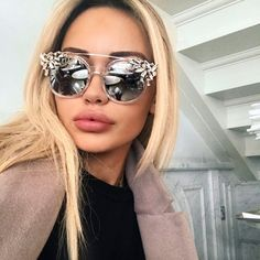 """These sporty chic shades upgrade any outfit. Lala comes in 3 colors, clear white, gray and black. - Synthetic materials - 55mm/2.16"""" width - 54mm/2.12"""" height - 100% UV protection Janice Joostema featuring Lala shades."""