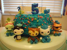 Homemade Octonauts bundt cake with fish themed candles and characters from my son's Octonaut toys:)
