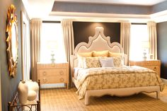 Joe Berkowitz Designed this bedroom for HGTV'S Show House Showdown. It features Black Walls and A Morroccan bed upholstered in linen to match the custom drapery. The bed is flanked by Empire style chests with metal accents.He used a pale blue paper to cover the coffered ceiling. All of this sits upon a camel plaid low pile carpet. Just one of the rooms in Berkowitz's show winning design.