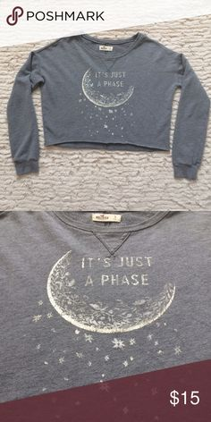 It's just a phase  Crop sweater Grey cropped sweatshirt  It's Just A Phase Boat neck Can be worn slightly off the shoulder Crop pullover Moon & stars Hollister  Cute with high waisted shorts or jeans Hollister Sweaters Crew & Scoop Necks
