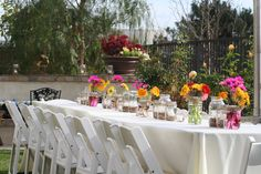 outdoor garden party with mason jar candle lights and gerber daisies