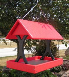 Amish Poly Fly-Through Bird Feeder This fly-though feeder is the perfect choice for backyard birders looking to expand and sustain a wide variety of songsters in their garden. With a large feeding tray and a distinctive design, this feeder is sure to keep your birds coming back for more.