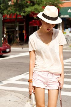 We love this look, with cut off shorts & a fedora