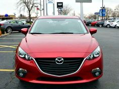 New 2015 Mazda Mazda3 i Grand Touring in Soul Red Metallic.