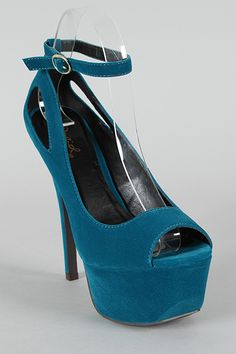 Stand tall in these fashionable platform pumps! Featuring smooth velvet upper, peep toe, scooped vamp, stiletto heel, chunky platform, cut out design, and adjustable ankle strap. Finished with lightly padded insole.