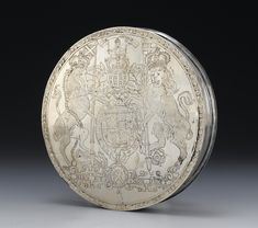 Seal box of silver, circular in two portions, engraved with the royal arms of Scotland and the arms of Don of Newton Don, by Thomas Ker, Edinburgh, Scotland, c. 1695