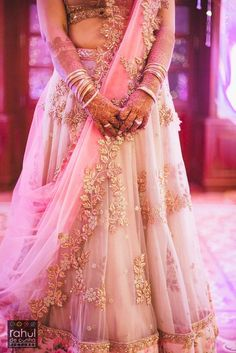 Bridal Details - Light Pink Net Lehenga | WedMeGood | Bride in a Fairytaly Net Lehengs with Flower Cutwork Patch on Border and a Scalloped Dupatta  #wedmegood #lehenga #indianwedding #indianbride #bridal #pink #net