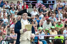 General George Washington reads the Declaration to the crowds at the National Archives