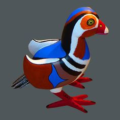 Collectors of larger sized sculptures will appreciate the size and scale of Carlos Morale's works. This Mandarin duck is symmetrical perfection with tail feathers carved. Striking color scheme to enli