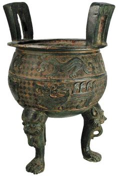 Three feet bronze vessel with inscriptions on the body and the dragon on the legs. Addresses contain two Chinese writings. Warren America, Northern Wei 750 BC