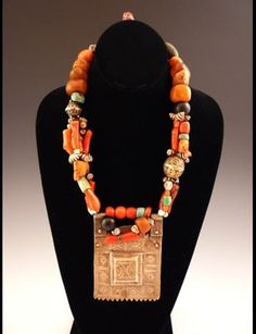Africa   Old North African Berber Necklace   This piece incorporates incised metal, coral, amber, shell and various beads.   Sold