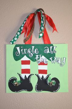 Christmas Canvas by LittleTicklebug on Etsy, $20.00-- I like the idea of a double ribbon. Very creative! -Brittany