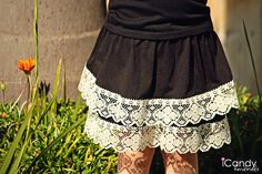 Laced up skirt - add lace to a skirt from Wal-Mart! Cheap and easy! Not to mention cute!