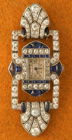 Rare French Art Deco articulated wristwatch by Verger Frères for Fouquet. Set in platinum with round diamonds, fine, natural, buff-topped and caliber-cut sapphires, ca.1925