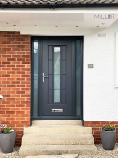 This type of steel garage doors is a very inspirational and amazing idea Composite Front Doors Uk, Grey Front Doors, Front Door Porch, Front Doors With Windows, Front Porch Design, Front Door Entrance, House Front Door, Door Gate Design, Garage Door Design