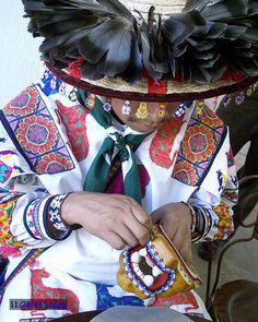 Huichol beading a mask.