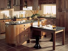 photo of chunky warm brown granite oak wood curved premier kitchens kitchen with granite worktop island kitchen worktop island kitchen island tiled flooring