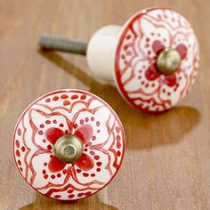 """World Market - Red Basic Ceramic Floral Knob, Set of 4 for $7.96 - so far these are my favorite and fit in with the """"mid-century modest"""" and """"not-so-modest mexican"""" theme that we're going for. But what drawer handles will go with this? Will need 20 if I don't put these pulls on the drawers. Will need 10 more if I put them on the drawers, and one more if I put it on the pantry door."""