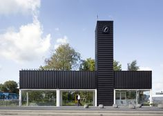 This railway station in the Netherlands by Dutch studio NL Architects comprises a cross formation of shipping containers that frame a transparent waiting room and cafe.