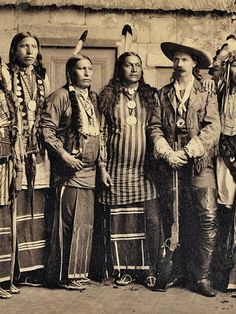 In this circa 1885 photo of a Buffalo Bill Wild West show troupe, Buffalo Bill Cody stands flanked by some of his Indian performers. Shown in this portion of the photo are the Pawnee Indians (from left) Eagle Chief, Knife Chief and Young Chief, next to Cody. – Courtesy Buffalo Bill Museum & Grave –