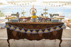 The Yellow Submarine @Catherine Feleky Club, Piraeus by De Plan V. Welcome dessert table, sea view, classic wooden table, festive party garland, submarine.