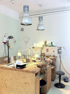 """David Taylor's Studio - Stockholm  """"Formerly a shop, his space is gallery-like from the street, with several silversmith's benches and an impressive array of pliers in one corner....""""."""