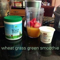 green smoothie with strawberries pineapple greek yogurt green smoothie with Amazing Grass Organic Wheat Grass Powder
