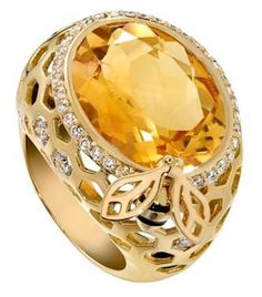 Golden Nectar cushion-cut citrine set in yellow gold with diamonds.