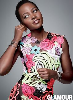 Lupita Nyong'o in a Christopher Kane dress, Balenciaga bracelets, and Me&Ro earrings in Glamour, December 2014