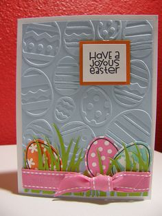 handmade Easter card ... diecut eggs amongs die cut grass ... pretty pink knotted ribbon ... embossing folder texture of large eggs ...