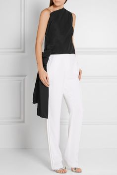 Spotted on Narciso Rodriguez's Spring '16 runway, this black top has knee-grazing side ties that elegantly sway as you walk. It's crafted from lightly structured cotton-blend faille and cut with a flattering high neckline. Team it with white pants and high-shine accessories.