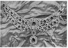"""A collier d'esclave of diamonds, emeralds, pearls made for Empress Alexandria to wear to the Bal des Costumes Russes in 1903. Faberge made it using stones from the Imperial collection, 39 emeralds from the Urals set in gold, Brazilian diamonds set in silver. It was sewn onto the Empress's dress. In the 1898 inventory this collier is noted as Alexandra's private property & described as """"unfinished."""" Sold between 1927 & 1936, current whereabouts unknown."""